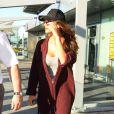 Nicole Scherzinger, sans bague, à l'aéroport d'Heathrow à Londres, le 16 mars 2014.