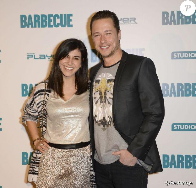 """Stéphane Rousseau et sa compagne Reem Kherici lors de l'avant-première du film """"Barbecue"""" au cinéma Gaumont Opéra à Paris, le 7 avril 2014."""