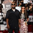 Ice Cube et sa femme Kimberly Woodruff aux MTV Movie Awards, Nokia Theatre L.A. Live, Los Angeles, le 13 avril 2014.