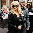 Christina Aguilera (enceinte) et son fiancé Matthew Rutler dans les rues de New York, le 17 avril 2014.
