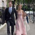 """Geri Halliwell avec sa fille Bluebell et son compagnon Christian Horner lors du mariage de Poppy Delevingne et de James Cook en l'église de """"St Paul's"""" à Londres, le 16 mai 2014."""
