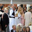 """Poppy Delevingne et Geri Halliwell lors du mariage de Poppy Delevingne et de James Cook en l'église de """"St Paul's"""" à Londres, le 16 mai 2014."""