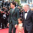 Mika, Valentina Pinault et François-Henri Pinault   lors de la montée des marches du film Saint Laurent et l'hommage au cinéma d'animation au Festival de Cannes le 17 mai 2014