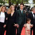 Lisa Azuelos, Julie Gayet, Mika et la fille de Salma Hayek, Valentina Pinault   lors de la montée des marches du film Saint Laurent et l'hommage au cinéma d'animation au Festival de Cannes le 17 mai 2014