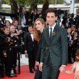 Julie Gayet, Mika   lors de la montée des marches du film Saint Laurent et l'hommage au cinéma d'animation au Festival de Cannes le 17 mai 2014