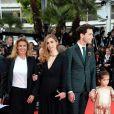 Julie Gayet, Mika et la fille de Salma Hayek, Valentina Pinault,   lors de la montée des marches du film Saint Laurent et l'hommage au cinéma d'animation au Festival de Cannes le 17 mai 2014
