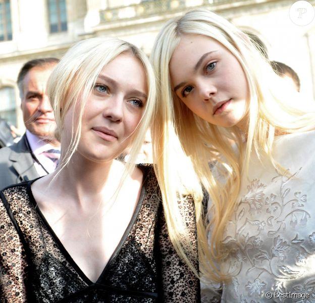 Dakota et Elle Fanning à Paris le 2 octobre 2013 pour le défilé Louis Vuitton lors de la Fashion Week. Les deux jeunes actrices descendraient du roi Edouard III d'Angleterre.