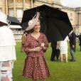 La comtesse Sophie de Wessex, élégante comme toujours, lors de la pluvieuse troisième garden party de l'année organisée à Buckingham Palace le 3 juin 2014.