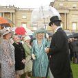 Camilla Parker Bowles lors de la pluvieuse troisième garden party de l'année organisée à Buckingham Palace le 3 juin 2014.