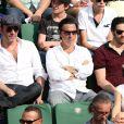 Jean Dujardin, Tahar Rahim et Yvan Attal à la finale homme des Internationaux de France de tennis de Roland Garros à Paris le 8 juin 2014.