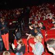 """Exclusif - Thomas Ngijol passe devant sa compagne Karole Rocher et leur fille lors de l'avant-première du film """"Fastlife"""" au cinéma Gaumont Marignan dans le cadre du 3e Champs-Elysées Film Festival à Paris, le 11 juin 2014."""
