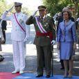 Le roi Juan Carlos Ier, la reine Sofia, le prince Felipe et la princesse Letizia lors de la journée des forces armées le 8 juin 2014 à Madrid.