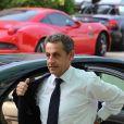 Nicolas Sarkozy arrive à l'hôtel Fairmont Monte-Carlo à Monaco le 18 juin 2014 où il donne une conférence lors du Deloitte World Meet.