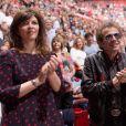 Exclusif - Philippe Manoeuvre et sa compagne Candice - People au concert de Johnny Hallyday au POPB de Bercy à Paris. Le 15 juin 2013.