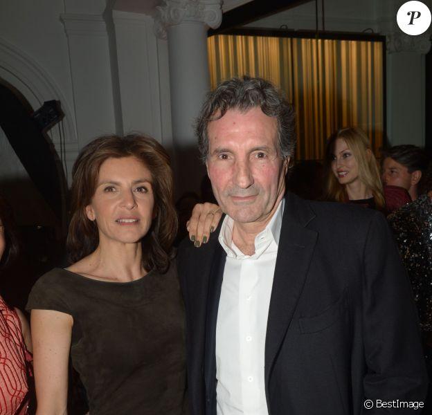 Jean-Jacques Bourdin et sa femme Anne Nivat à la soirée Néo Burlesque à l'hôtel Vernet à Paris le 20 mars 2014.
