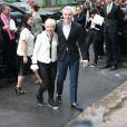 Catherine Martin et Baz Luhrmann arrivent au Grand Palais pour assister au défilé haute couture Chanel. Paris, le 8 juillet 2014.