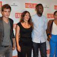 """Clément Moreau, Karole Rocher, son compagnon Thomas Ngijol et Olivia Biffot lors de l'avant-première du film """"Fastlife"""" au cinéma Gaumont Capucines Opéra à Paris, le 15 juillet 2014."""
