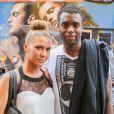 """Exclusif - Frédéric Piquionne et sa compagne arrivent à l'avant-première du film """"Fastlife"""" au cinéma Gaumont Capucines Opéra à Paris, le 15 juillet 2014."""