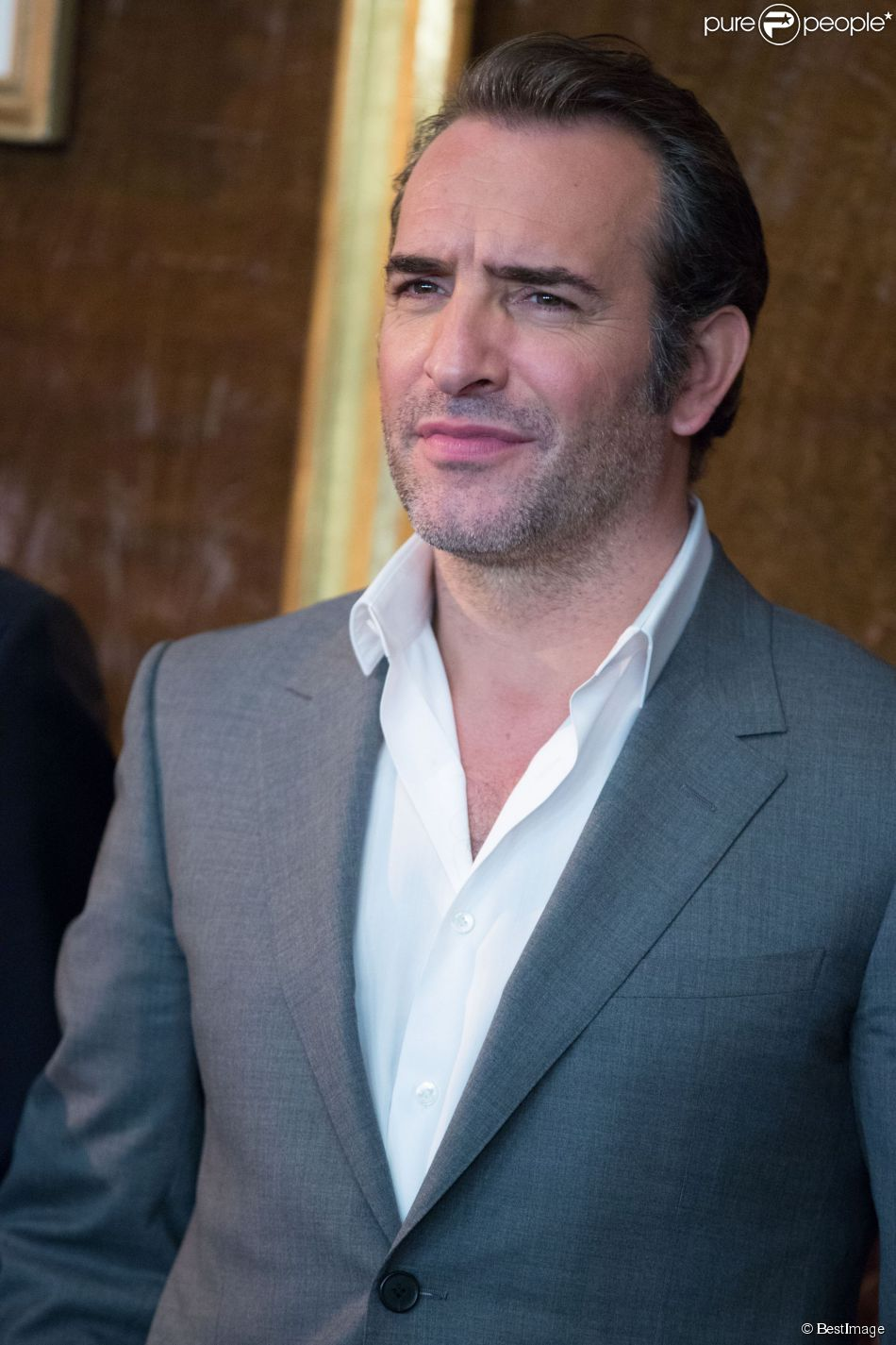 Jean dujardin lors du photocall du film monuments men l for Jean dujardin photo