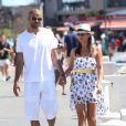 Tony Parker et sa fiancée Axelle Francine se promènent main dans la main pendant leurs vacances à Saint-Tropez, le 20 août 2013.