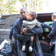 Kanye West et sa fille North arrivent au Royal Monceau. Paris, le 24 septembre 2014.
