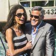 George Clooney et Amal Alamuddin à leur arrivée à Venise le 26 septembre 2014 pour le week-end de leur mariage.