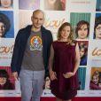 """Julien Neel et Ludivine Sagnier, enceinte lors de l'avant-première du film """"Lou ! Journal infime"""" au cinéma MK2 Bibliothèque à Paris, le 28 septembre 2014."""
