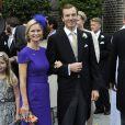 La princesse Carolina de Bourbon-Parme avec son mari   Albert Brenninkmeijer au mariage de son frère le prince Jaime et de  Viktoria Cservenyak le 5 octobre 2013 à Appeldorn.
