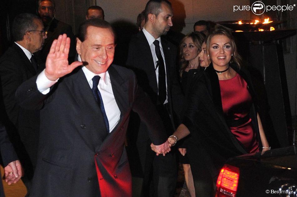 Silvio Berlusconi et sa très jeune compagne Francesca Pascale à la sortie du mariage de Michelle Hunziker et Tomaso Trussardi à Bergame, le 10 octobre 2014