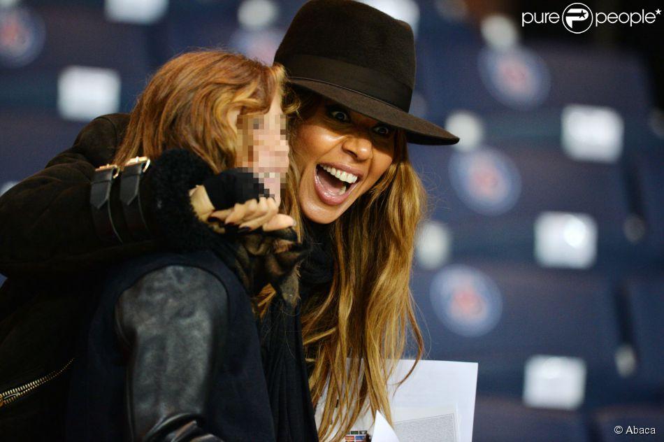 Cathy Guetta et son fils Tim Elvis lors du match PSG-APOEL Nicosie à Paris le 5 novembre 2014.