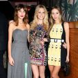 Alexa Chung, Poppy Delevingne et Harley Viera-Newton assistent au dîner d'annonce de la collection Solid & Striped x Poppy Delevingne à l'Happiest Hour. New York, le 12 novembre 2014.