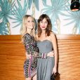 Poppy Delevingne et Alexa Chung assistent au dîner d'annonce de la collection Solid & Striped x Poppy Delevingne à l'Happiest Hour. New York, le 12 novembre 2014.