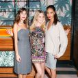 Alexa Chung, Poppy Delevingne et Joan Smalls assistent au dîner d'annonce de la collection Solid & Striped x Poppy Delevingne à l'Happiest Hour. New York, le 12 novembre 2014.