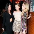 Julia Restoin-Roitfeld, Eugenie Niarchos et Poppy Delevingne assistent au dîner d'annonce de la collection Solid & Striped x Poppy Delevingne à l'Happiest Hour. New York, le 12 novembre 2014.