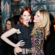 Karen Elson et Poppy Delevingne assistent au dîner d'annonce de la collection Solid & Striped x Poppy Delevingne à l'Happiest Hour. New York, le 12 novembre 2014.