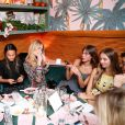 Jessica Hart, Poppy Delevingne, Alexa Chung et Harley Viera-Newton assistent au dîner d'annonce de la collection Solid & Striped x Poppy Delevingne à l'Happiest Hour. New York, le 12 novembre 2014.