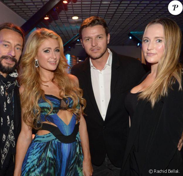 Bob Sinclar et Paris Hilton posant avec Gareth Wittstock et sa compagne Roisin Galvin lors des NRJ DJ Music Awards le 12 novembre 2014 à Monaco.