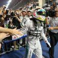 Lewis Hamilton sacré champion du monde de Formule 1 lors du Grand Prix d'Abou Dhabi, le 23 novembre 2014, aux Emirats Arabes Unis.