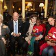 Le professeur Francine Leca, Christophe Laure (Directeur de l'InterContinental Paris le Grand), Inès de la Fressange et Sandrine Quétier assistent au coup d'envoi de la vente des Goûters du Coeur au Café de la Paix, Place de l'Opéra à Paris. Le 2 décembre 2014.