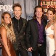 Tyler Hubbard and Brian Kelley of Florida Georgia Line with Hayley Stommel and Brittney Marie Cole attending the 2014 American Country Countdown Awards on FOX at the Music City Center on December 15, 2014 in Nashville, Tennessee, USA. Photo by Curtis Hilbun/AFF/ABACAPRESS.COM16/12/2014 - Nashville