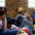 Le prince Harry dans un centre pour orphelins porteurs du VIH le 9  décembre 2014 lors de sa visite privée pour suivre les actions de son association Sentebale.