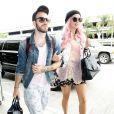 La chanteuse Kesha arrive à l'aéroport de Los Angeles avec un ami pour prendre un vol, le 30 juin 2014.