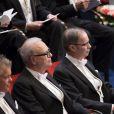 Patrick Modiano et Jean Tirole lors de la cérémonie de remise des Prix Nobel à Stockholm le 10 décembre 2014