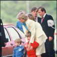 Lady Di avec les princes William et Harry en 1987 lors d'un match de polo à Windsor.