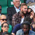 M. Pokora et sa compagne Scarlett Baya assistent aux Internationaux de France de tennis de Roland-Garros à Paris le 2 juin 2014.