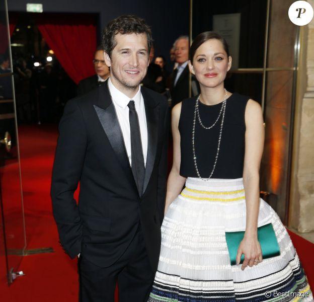 Guillaume Canet et sa compagne Marion Cotillard (robe Dior) arrivant à la 40ème cérémonie des Cesar au théâtre du Châtelet à Paris, le 20 février 2015.