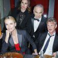 Alain Terzian sa femme Prune et Charlize Theron (bijoux Cartier), Sean Penn - Dîner au Fouquet's lors de la 40e cérémonie des César à Paris le 20 février 2015.