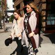 Blake Lively (enceinte) et Amber Tamblyn à New York le 18 octobre 2014