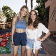 Gigi Hadid et Ashley Greene à la pool party organisée par Just Jared lors du festival de Coachella, à Indio, le 11 avril 2015