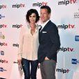 L'acteur James Denton arrive en compagnie de Catherine Bell à la soirée d'ouverture du MIPTV à l'hôtel Majestic à Cannes le 13 avril 2015